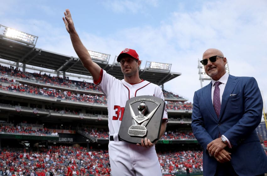 The 2016 National League Cy Young Award is presented to Max Scherzer #32 of the Washington Nationals before the start of the Opening Day game against the Miami Marlins on April 3, 2017 at Nationals Park in Washington, DC. The Nationals won 4-2. Also pictured is Nationals General Manager Mike Rizzo (R). (Photo by Win McNamee/Getty Images)