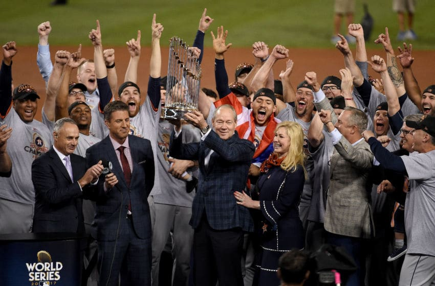 LOS ANGELES, CA - NOVEMBER 01: Houston Astros owner and chairman Jim Crane hoists the Commissioner's Trophy after the Astros defeated the Los Angeles Dodgers 5-1 in game seven to win the 2017 World Series at Dodger Stadium on November 1, 2017 in Los Angeles, California. (Photo by Kevork Djansezian/Getty Images)