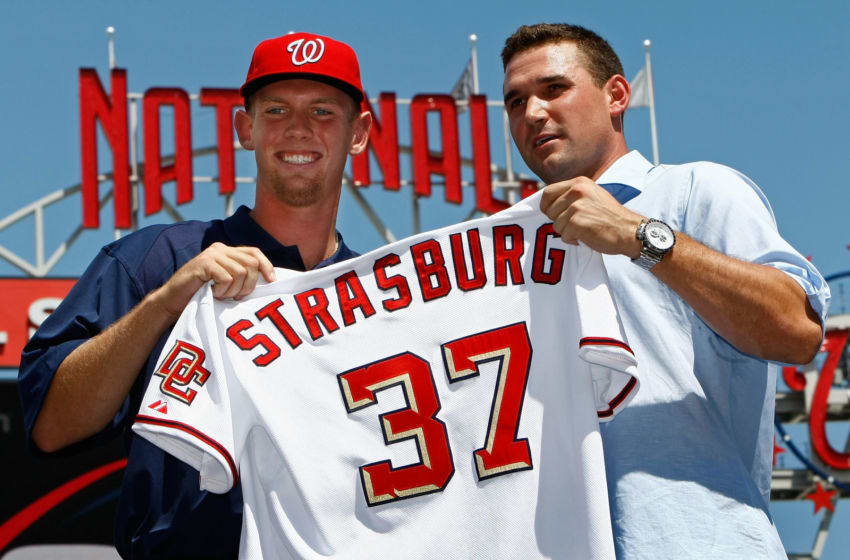 WASHINGTON - AUGUST 21: Stephen Strasburg (L), the overall first pick in the 2009 MLB Draft, is presented with his jersey by Nationals third baseman Ryan Zimmerman (R) after being introduced at Nationals Park August 21, 2009 in Washington, DC. Strasburg, a right handed pitcher from San Diego State University, signed with the Nationals earlier this week wth a record contract for an amateur player. (Photo by Win McNamee/Getty Images)