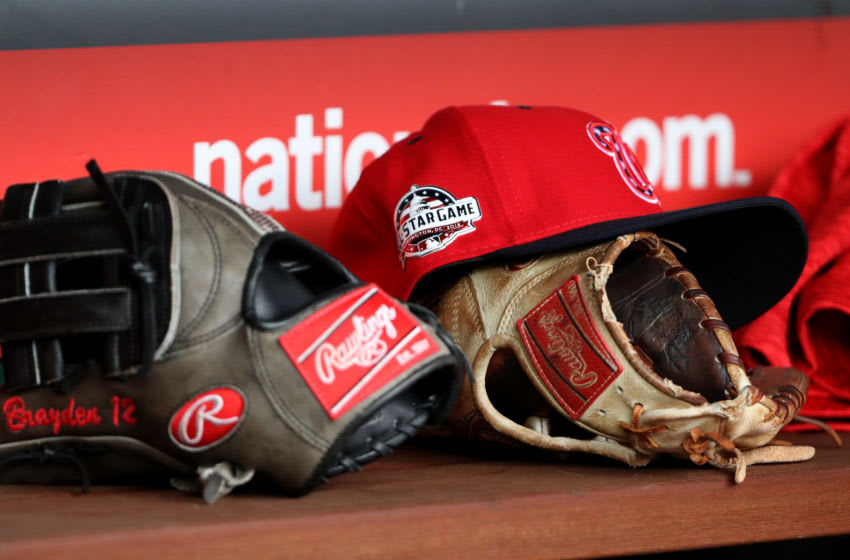 WASHINGTON, DC - APRIL 7: Washington Nationals hats and gloves sit in the dugout during the Nationals game against the New York Mets at Nationals Park on April 7, 2018 in Washington, DC. (Photo by Rob Carr/Getty Images)