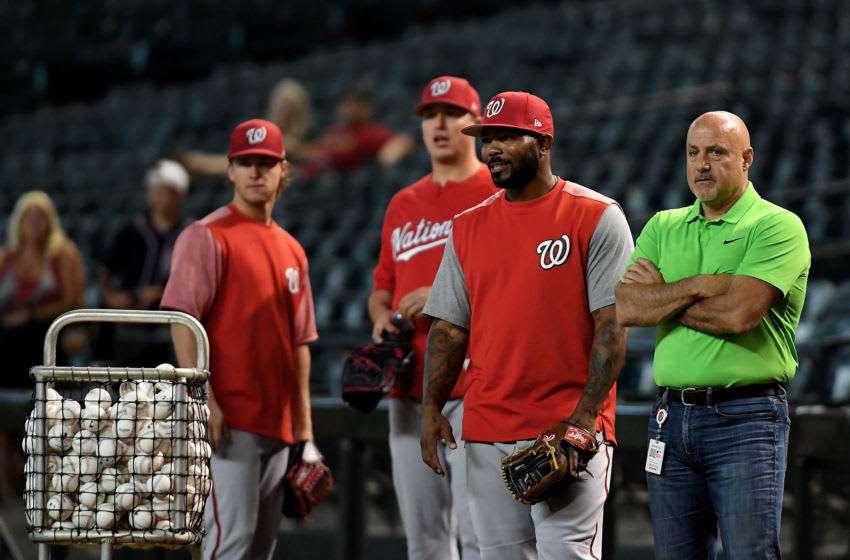 PHOENIX, AZ - MAY 11: Howie Kendrick #12 and general manager Mike Rizzo of the Washington Nationals look on during batting practice prior to the MLB game against the Arizona Diamondbacks at Chase Field on May 11, 2018 in Phoenix, Arizona. (Photo by Jennifer Stewart/Getty Images)