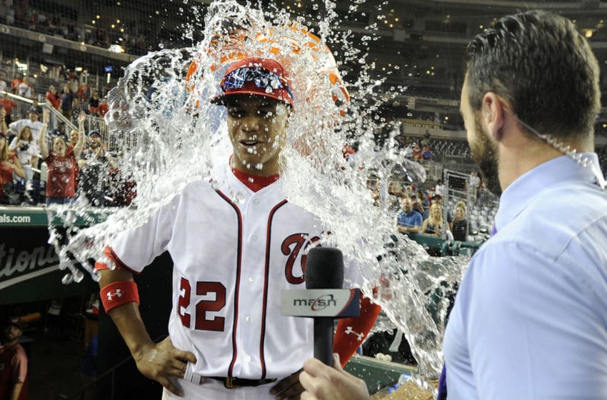 WASHINGTON, DC - MAY 21: Juan Soto #22 of the Washington Nationals is doused with water after a 10-2 victory against the San Diego Padres at Nationals Park on May 21, 2018 in Washington, DC. (Photo by Greg Fiume/Getty Images)
