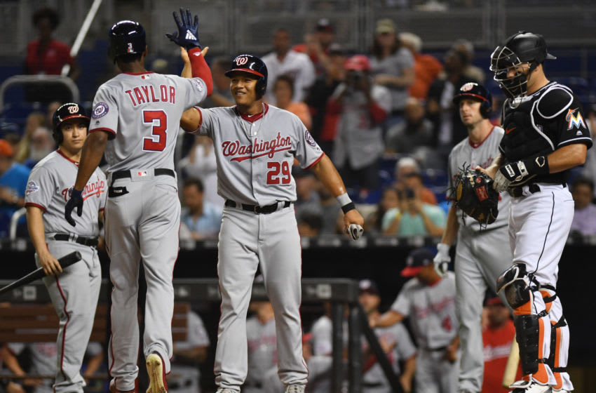 MIAMI, FL - MAY 25: Michael Taylor #3 of the Washington Nationals high fives Pedro Severino #29 at home plate after hitting a home run during the second inning against the Miami Marlins at Marlins Park on May 25, 2018 in Miami, Florida. (Photo by Mark Brown/Getty Images)