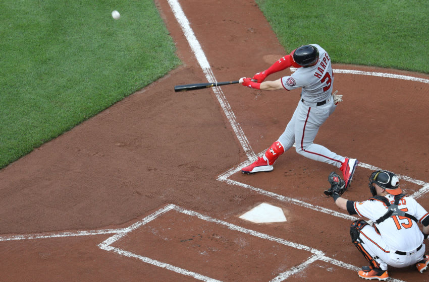 BALTIMORE, MD - MAY 29: Bryce Harper #34 of the Washington Nationals follows hits a solo home run against the Baltimore Orioles in the first inning at Oriole Park at Camden Yards on May 29, 2018 in Baltimore, Maryland. (Photo by Rob Carr/Getty Images)
