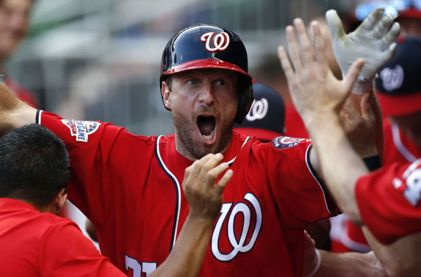 ATLANTA, GA - JUNE 02: Pitcher and pinch hitter Max Scherzer #31 of the Washington Nationals is congratulated in the dugout after scoring in the 14th inning during the game against the Atlanta Braves at SunTrust Park on June 2, 2018 in Atlanta, Georgia. (Photo by Mike Zarrilli/Getty Images)