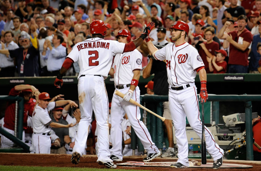 WASHINGTON, DC - SEPTEMBER 05: Roger Bernadina #2 celebrates with Bryce Harper #34 of the Washington Nationals after hitting a solo home run in the third inning against the Chicago Cubs at Nationals Park on September 5, 2012 in Washington, DC. (Photo by Patrick McDermott/Getty Images)