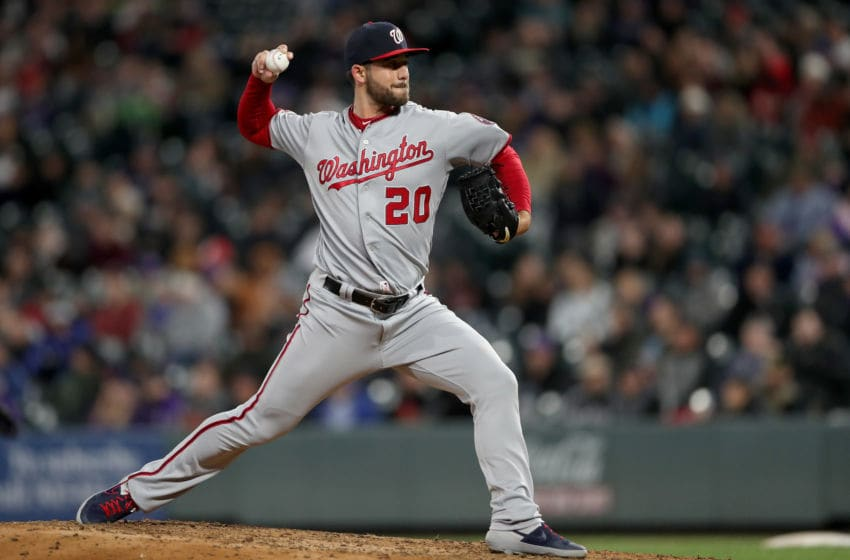 DENVER, COLORADO - APRIL 22: Pitcher Kyle Barraclough #20 of the Washington Nationals throws in the eighth inning against the Colorado Rockies at Coors Field on April 22, 2019 in Denver, Colorado. (Photo by Matthew Stockman/Getty Images)
