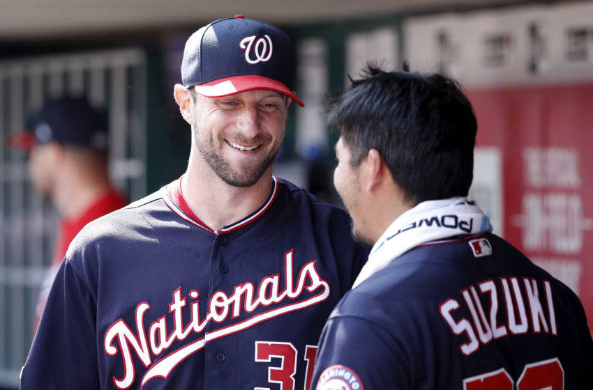 CINCINNATI, OH - JUNE 02: Max Scherzer #31 of the Washington Nationals talks to Kurt Suzuki #28 in the dugout following the eighth inning against the Cincinnati Reds at Great American Ball Park on June 2, 2019 in Cincinnati, Ohio. The Nationals won 4-1. (Photo by Joe Robbins/Getty Images)