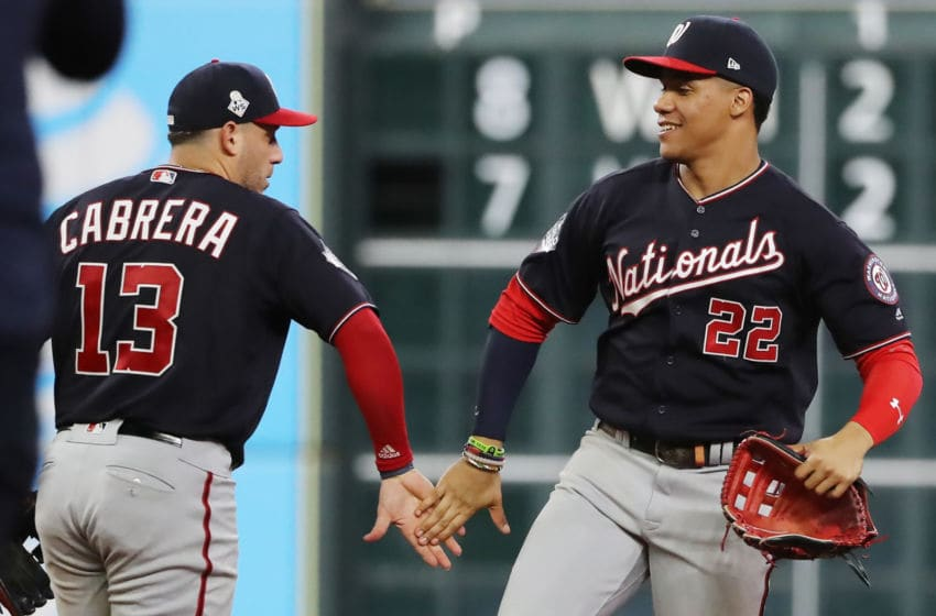HOUSTON, TEXAS - OCTOBER 23: Juan Soto #22 and Asdrubal Cabrera #13 of the Washington Nationals celebrate their 12-3 win over the Houston Astros in Game Two of the 2019 World Series at Minute Maid Park on October 23, 2019 in Houston, Texas. (Photo by Elsa/Getty Images)