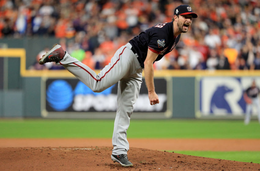 HOUSTON, TEXAS - OCTOBER 30: Max Scherzer #31 of the Washington Nationals delivers the pitch against the Houston Astros during the second inning in Game Seven of the 2019 World Series at Minute Maid Park on October 30, 2019 in Houston, Texas. (Photo by Mike Ehrmann/Getty Images)