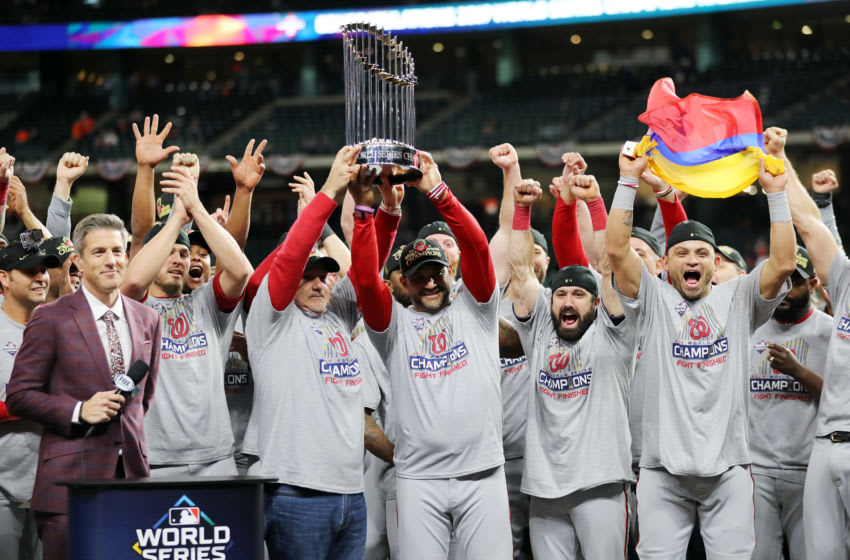 HOUSTON, TEXAS - OCTOBER 30: Manager Dave Martinez #4 of the Washington Nationals hoists the Commissioners Trophy after defeating the Houston Astros 6-2 in Game Seven to win the 2019 World Series in Game Seven of the 2019 World Series at Minute Maid Park on October 30, 2019 in Houston, Texas. (Photo by Elsa/Getty Images)