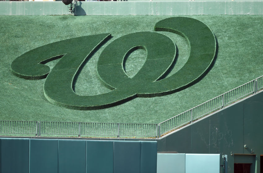 The Washington Nationals logo in centerfield grass before a baseball game against the Los Angeles Dodgers at Nationals Park on July 26, 2019 in Washington, DC. (Photo by Mitchell Layton/Getty Images) *** Local Caption ***