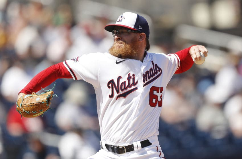WEST PALM BEACH, FLORIDA - MARCH 12: Sean Doolittle #63 of the Washington Nationals delivers a pitch against the New York Yankees during a Grapefruit League spring training game at FITTEAM Ballpark of The Palm Beaches on March 12, 2020 in West Palm Beach, Florida. (Photo by Michael Reaves/Getty Images)