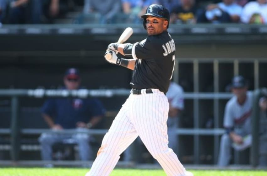 Sep 13, 2015; Chicago, IL, USA; Chicago White Sox second baseman Micah Johnson (7) hits a single during the sixth inning against the Minnesota Twins at U.S Cellular Field. Mandatory Credit: Caylor Arnold-USA TODAY Sports