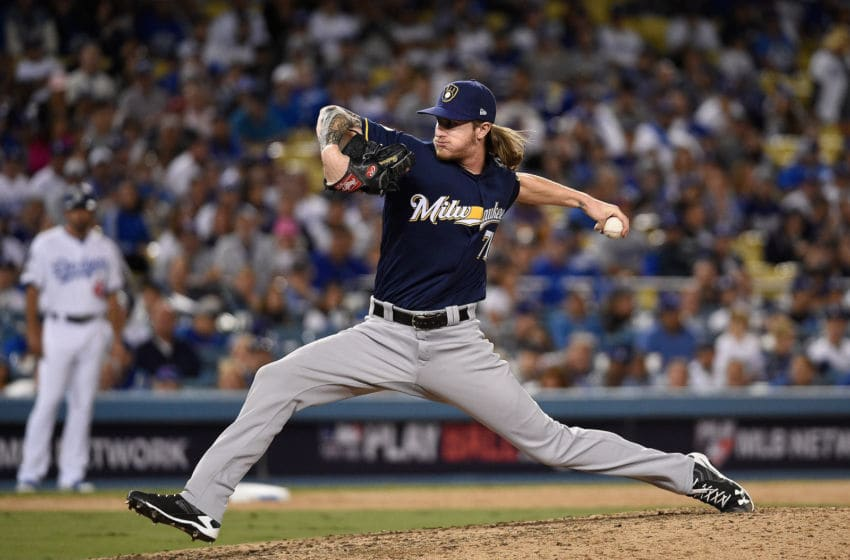 LOS ANGELES, CA - OCTOBER 15: Pitcher Josh Hader #71 of the Milwaukee Brewers pitches in the eighth inning during Game Three of the National League Championship Series against the Los Angeles Dodgers at Dodger Stadium on October 15, 2018 in Los Angeles, California. (Photo by Kevork Djansezian/Getty Images)