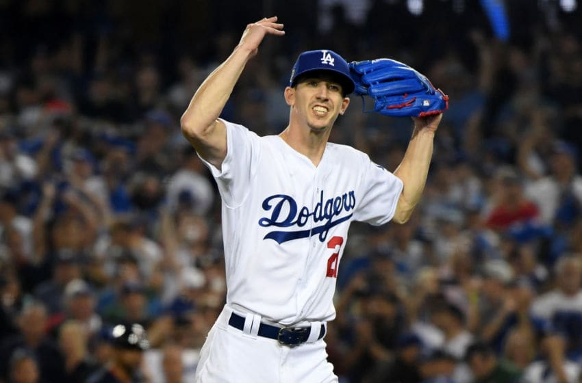 LOS ANGELES, CA - OCTOBER 26: Walker Buehler #21 of the Los Angeles Dodgers reacts after retiring the side on a strike out during the seventh inning against the Boston Red Sox in Game Three of the 2018 World Series at Dodger Stadium on October 26, 2018 in Los Angeles, California. (Photo by Harry How/Getty Images)