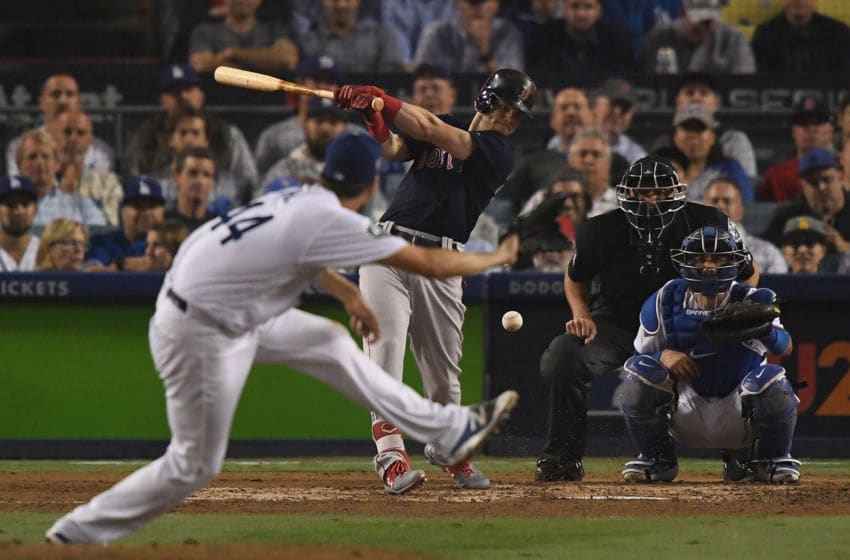 LOS ANGELES, CA - OCTOBER 27: Andrew Benintendi #16 of the Boston Red Sox hits the ball against Rich Hill #44 of the Los Angeles Dodgers in Game Four of the 2018 World Series at Dodger Stadium on October 27, 2018 in Los Angeles, California. (Photo by Kevork Djansezian/Getty Images)