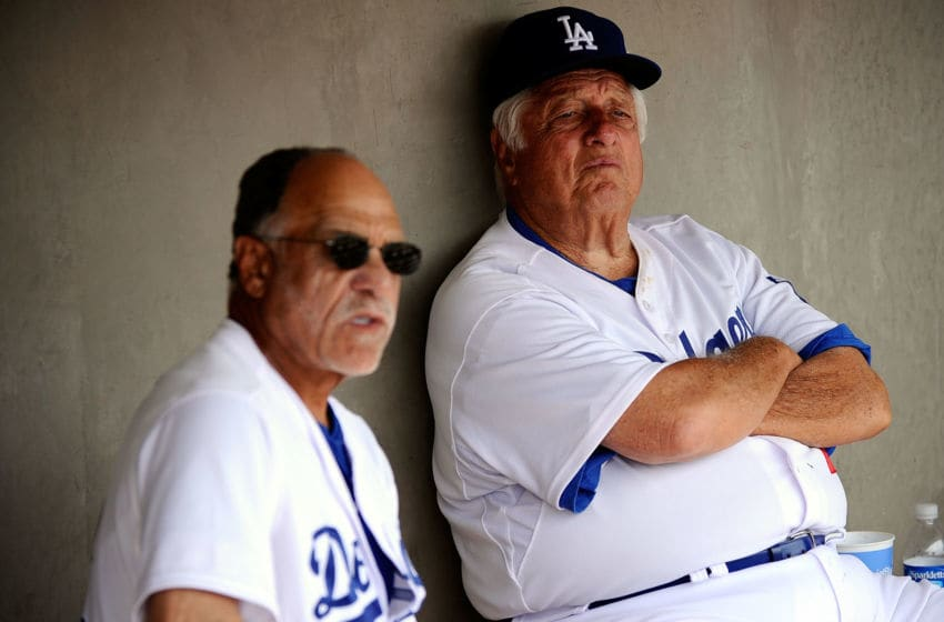 GLENDALE, AZ - MARCH 15: Hall of Fame manager Tommy Lasorda #2 of the Los Angeles Dodgers speaks to first base coach Davey Lopes in the dugout prior to the start of the spring training baseball game against the Texas Rangers at Camelback Ranch on March 15, 2011 in Glendale, Arizona. (Photo by Kevork Djansezian/Getty Images)