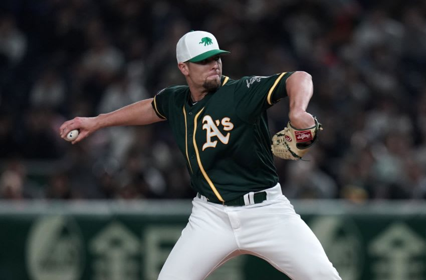 TOKYO, JAPAN - MARCH 17: Pitcher Blake Treinen #39 of the Oakland Athletics throws in the bottom of 8th inning during the game between Hokkaido Nippon-Ham Fighters and Oakland Athletics at Tokyo Dome on March 17, 2019 in Tokyo, Japan. (Photo by Masterpress/Getty Images)