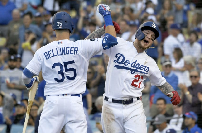LOS ANGELES, CA - JUNE 22: Cody Bellinger #35 congratulates Alex Verdugo #27 of the Los Angeles Dodgers on his fifth inning solo home run against the Colorado Rockies at Dodger Stadium on June 22, 2019 in Los Angeles, California. (Photo by John McCoy/Getty Images)