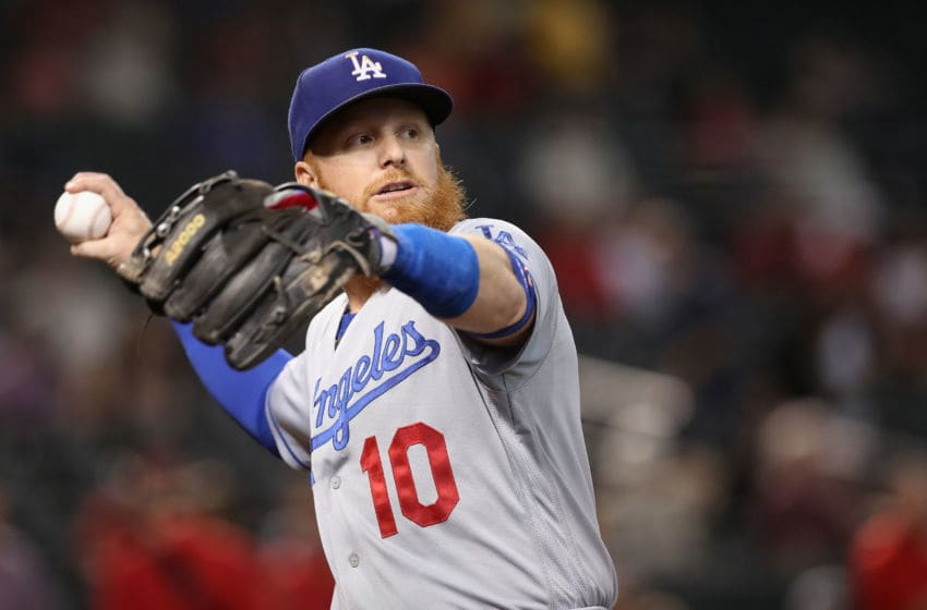 PHOENIX, ARIZONA - JUNE 05: Justin Turner #10 of the Los Angeles Dodgers warms up before the MLB game against the Arizona Diamondbacks at Chase Field on June 05, 2019 in Phoenix, Arizona. The Diamondbacks defeated the Dodgers 3-2 in 11 innings. (Photo by Christian Petersen/Getty Images)