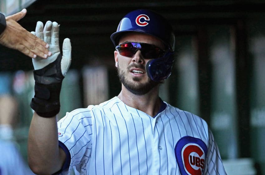 CHICAGO, ILLINOIS - JULY 12: Kris Bryant #17 of the Chicago Cubs is congratulated by teammates in the dugout after scoring the game-winning run in the 8th inning against the Pittsburgh Pirates at Wrigley Field on July 12, 2019 in Chicago, Illinois. The Cubs defeated the Pirates 4-3. (Photo by Jonathan Daniel/Getty Images)
