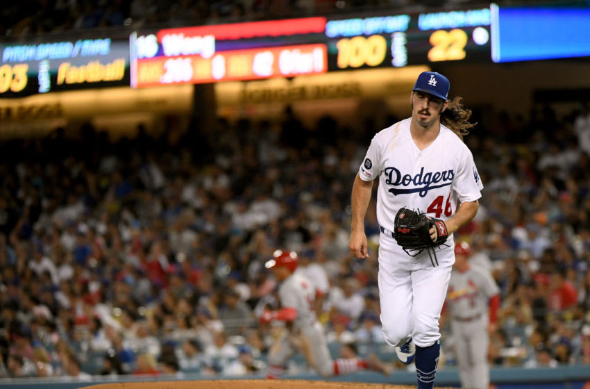 LOS ANGELES, CALIFORNIA - AUGUST 05: Tony Gonsolin #46 of the Los Angeles Dodgers runs to cover third base after a double by Kolten Wong #16 of the St. Louis Cardinals, the first Cardinals hit of the game, during the fifth inning at Dodger Stadium on August 05, 2019 in Los Angeles, California. (Photo by Harry How/Getty Images)