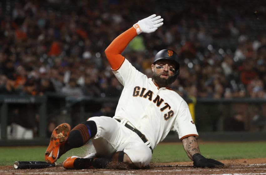 SAN FRANCISCO, CA - SEPTEMBER 09: Kevin Pillar #1 of the San Francisco Giants slides to score at home plate during the sixth inning against the Pittsburgh Pirates at Oracle Park on September 9, 2019 in San Francisco, California. (Photo by Stephen Lam/Getty Images)