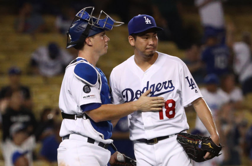 LOS ANGELES, CALIFORNIA - SEPTEMBER 02: Catcher Will Smith #16 and pitcher Kenta Maeda #18 of the Los Angeles Dodgers celebrate after the MLB game against the Colorado Rockies at Dodger Stadium on September 02, 2019 in Los Angeles, California. The Dodgers defeated the Rockies 16-9. (Photo by Victor Decolongon/Getty Images)