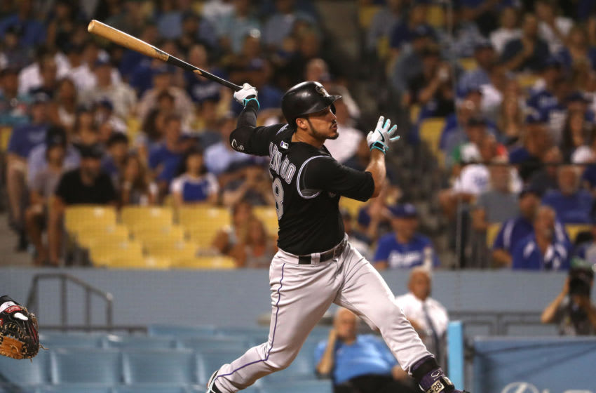 LOS ANGELES, CALIFORNIA - SEPTEMBER 03: Nolan Arenado #28 of the Colorado Rockies hits a solo home run in the fourth inning of the MLB game against the Los Angeles Dodgers at Dodger Stadium on September 03, 2019 in Los Angeles, California. (Photo by Victor Decolongon/Getty Images)