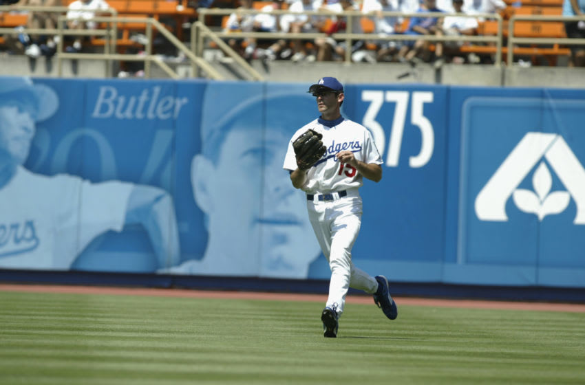 LOS ANGELES - JULY 16: Outfielder Shawn Green #15 of the Los Angeles Dodgers runs in from the outfield during the game against the St. Louis Cardinals in their game on July 16, 2002 at Dodger Stadium in Los Angeles, California. The Cardinals won 9-2. (Photo by Stephen Dunn/Getty Images)