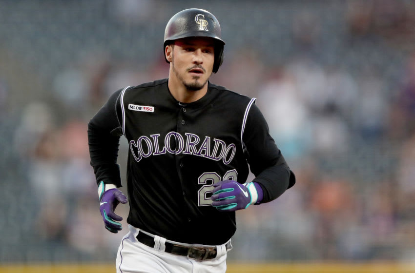 DENVER, COLORADO - SEPTEMBER 13: Nolan Arenado #28 of the Colorado Rockies circles the bases after hitting a 2 RBI home run in the first inning against the San Diego Padres at Coors Field on September 13, 2019 in Denver, Colorado. (Photo by Matthew Stockman/Getty Images)