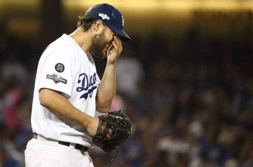 LOS ANGELES, CALIFORNIA - OCTOBER 04: Clayton Kershaw #22 of the Los Angeles Dodgers reacts after giving up a double to Victor Robles #16 of the Washington Nationals in the sixth inning in game two of the National League Division Series at Dodger Stadium on October 04, 2019 in Los Angeles, California. (Photo by Sean M. Haffey/Getty Images)
