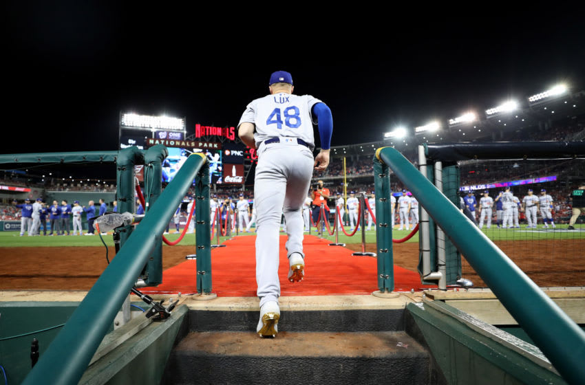 WASHINGTON, DC - OCTOBER 06: Gavin Lux #48 of the Los Angeles Dodgers takes the field during team introductions before Game 3 of the NLDS between the Los Angeles Dodgers and the Washington Nationals at Nationals Park on October 06, 2019 in Washington, DC. (Photo by Rob Carr/Getty Images)