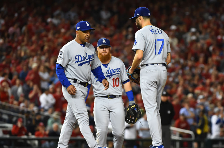WASHINGTON, DC - OCTOBER 06: Pitcher Joe Kelly #17 of the Los Angeles Dodgers gets a visit by manager Dave Roberts and is pulled in the sixth inning of Game 3 of the NLDS against the Washington Nationals at Nationals Park on October 06, 2019 in Washington, DC. (Photo by Will Newton/Getty Images)