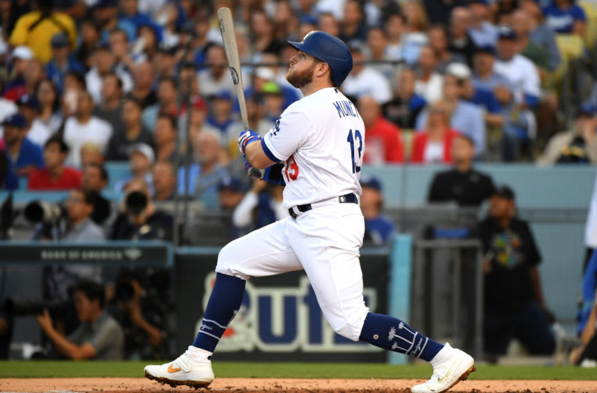 LOS ANGELES, CALIFORNIA - OCTOBER 09: Max Muncy #13 of the Los Angeles Dodgers hits a two run home run in the first inning of game five of the National League Division Series against the Washington Nationals at Dodger Stadium on October 09, 2019 in Los Angeles, California. (Photo by Harry How/Getty Images)