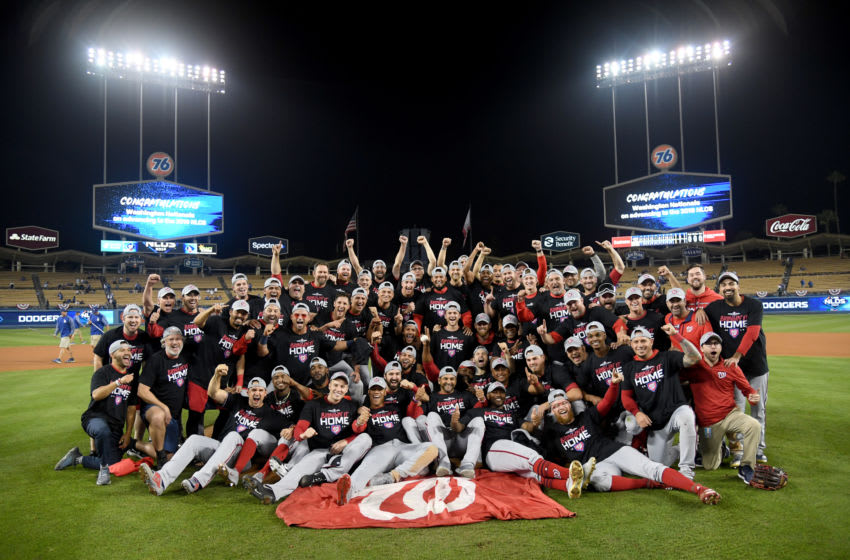 LOS ANGELES, CALIFORNIA - OCTOBER 09: The Washington Nationals celebrate defeating the Los Angeles Dodgers 7-3 in ten innings in game five to win the National League Division Series at Dodger Stadium on October 09, 2019 in Los Angeles, California. (Photo by Harry How/Getty Images)
