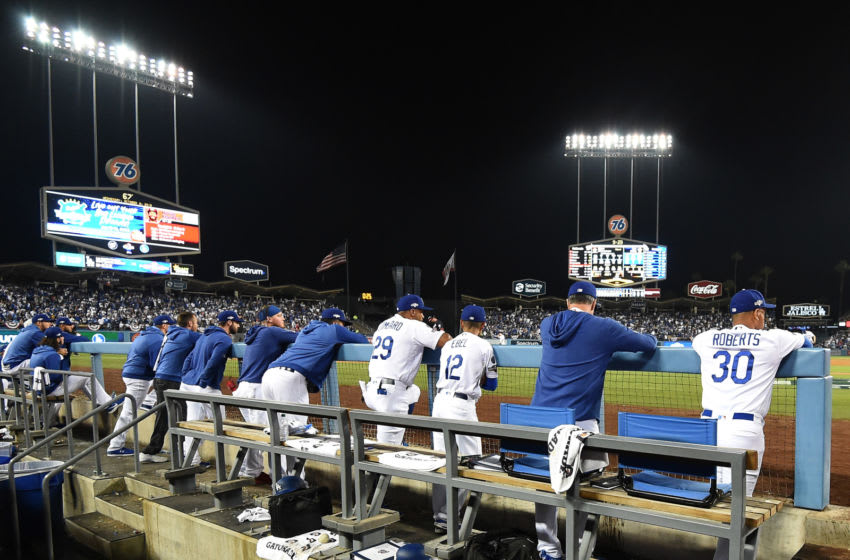 LOS ANGELES, CALIFORNIA - OCTOBER 09: The Los Angeles Dodgers look on from the dug out en route to losing to the Washington Nationals 7-3 in ten innings of game five and the National League Division Series at Dodger Stadium on October 09, 2019 in Los Angeles, California. (Photo by Harry How/Getty Images)