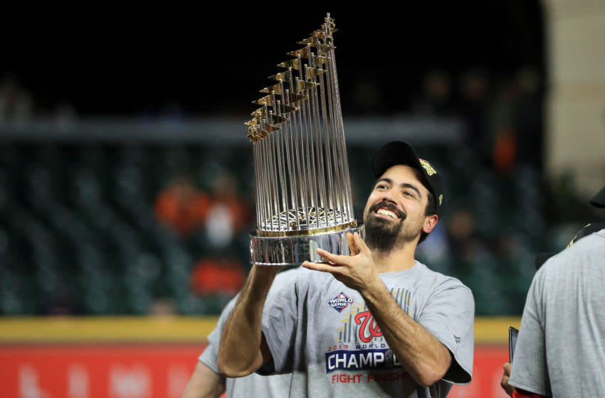 HOUSTON, TEXAS - OCTOBER 30: Anthony Rendon #6 of the Washington Nationals hoists the Commissioners Trophy after defeating the Houston Astros 6-2 in Game Seven to win the 2019 World Series in Game Seven of the 2019 World Series at Minute Maid Park on October 30, 2019 in Houston, Texas. (Photo by Mike Ehrmann/Getty Images)