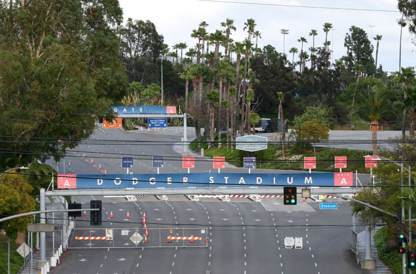 A quiet scene at Dodger Stadium in Los Angeles, California on March 26, 2020, on what was supposed to be the Major League Baseball season-opener against the San Francisco Giants, cancelled due to the coronavirus pandemic. - A staggering 3.3 million workers filed claims in the week ending March 21, the highest ever recorded, the Labour Department said Thursday, in a report that laid bare the devastating impact of the health crisi on the US economy. (Photo by Frederic J. BROWN / AFP) (Photo by FREDERIC J. BROWN/AFP via Getty Images)