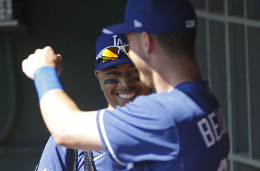 GLENDALE, ARIZONA - FEBRUARY 24: Mookie Betts #50 of the Los Angeles Dodgers (L) jokes with teammate Cody Bellinger #35 prior to a Cactus League spring training game against the Chicago White Sox at Camelback Ranch on February 24, 2020 in Glendale, Arizona. (Photo by Ralph Freso/Getty Images)