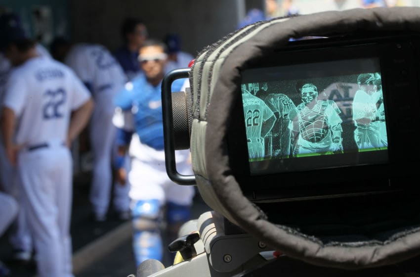LOS ANGELES, CA - AUGUST 14: A television camera focuses on catcher Dioner Navarro #30 of the Los Angeles Dodgers in the dugout before the game with the Houston Astros on August 14, 2011 at Dodger Stadium in Los Angeles, California. The Dodgers won 7-0. (Photo by Stephen Dunn/Getty Images)