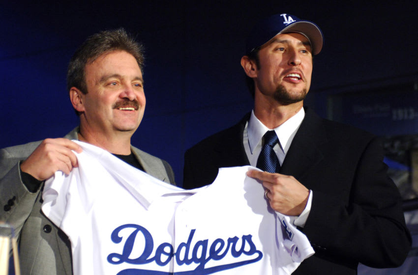 Los Angeles Dodgers general manager Ned Colletti (left) and Nomar Garciaparra pose at press conference to announce signing of Garciaparra to a one-year contract at Dodger Stadium in Los Angeles, Calif. on Monday, December 19, 2005. (Photo by Kirby Lee/Getty Images)