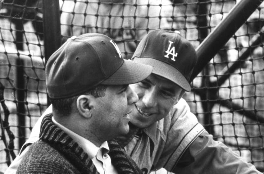LOS ANGELES, CA - 1958: Ex-Brooklyn Dodger catcher Roy Campanella meets with Pee Wee Reese at the batting cages in 1958 in Dodger Stadium in Los Angeles, California. (Photo Reproduction by Transcendental Graphics/Getty Images)