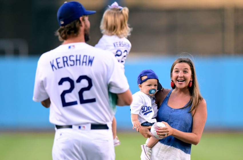 LOS ANGELES, CA - JULY 26: Ellen Kershaw with Charley Kershaw, smile at Clayton Kershaw #22 of the Los Angeles Dodgers, as he holds his daughter Cali Ann Kershaw before the game against the Minnesota Twins at Dodger Stadium on July 26, 2017 in Los Angeles, California. (Photo by Harry How/Getty Images)