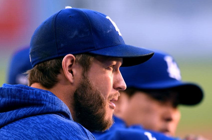 LOS ANGELES, CA - JUNE 15: Clayton Kershaw #22 of the Los Angeles Dodgers watches from the bench during the first inning against the San Francisco Giants at Dodger Stadium on June 15, 2018 in Los Angeles, California. (Photo by Harry How/Getty Images)