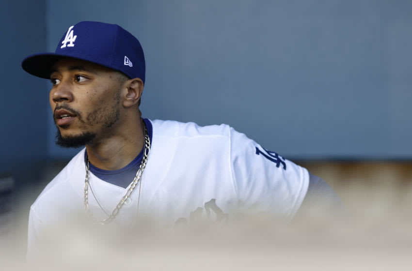 LOS ANGELES, CALIFORNIA - MAY 28: Mookie Betts #50 of the Los Angeles Dodgers walks into the dugout prior to a game against the San Francisco Giants at Dodger Stadium on May 28, 2021 in Los Angeles, California. (Photo by Michael Owens/Getty Images)