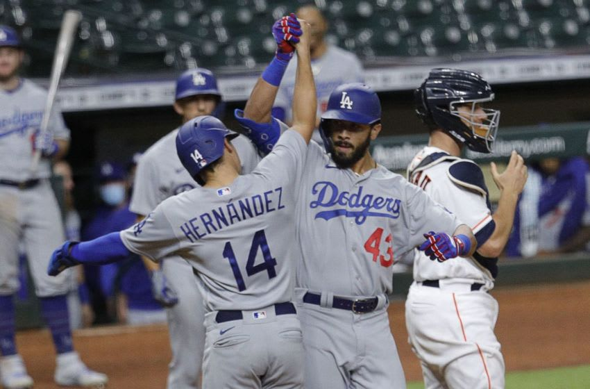 HOUSTON, TEXAS - JULY 29: Edwin Rios #43 of the Los Angeles Dodgers celebrates with Enrique Hernandez #14 after hitting a two-run home run in the thirteenth inning against the Houston Astros at Minute Maid Park on July 29, 2020 in Houston, Texas. (Photo by Bob Levey/Getty Images)