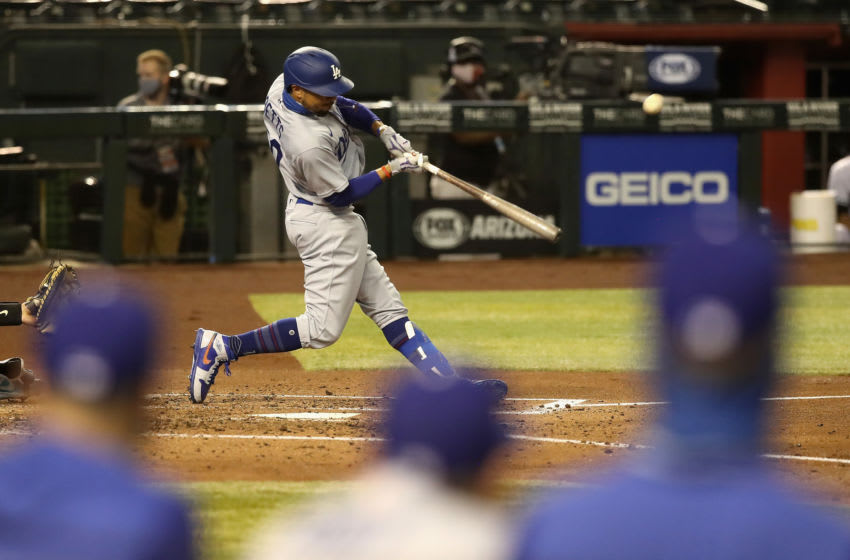 PHOENIX, ARIZONA - JULY 31: Mookie Betts #50 of the Los Angeles Dodgers hits a solo home run against the Arizona Diamondbacks during the fourth inning of the MLB game at Chase Field on July 31, 2020 in Phoenix, Arizona. (Photo by Christian Petersen/Getty Images)