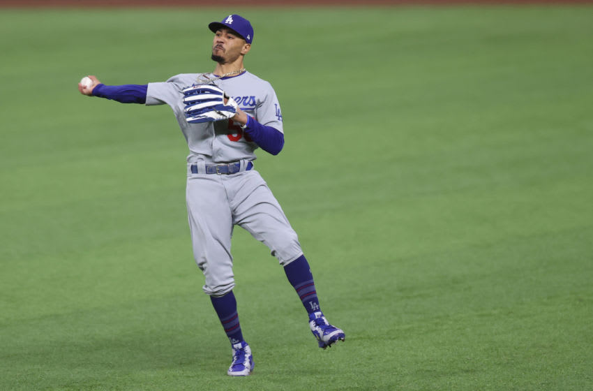 ARLINGTON, TEXAS - OCTOBER 16: Mookie Betts #50 of the Los Angeles Dodgers catches a fly ball against the Atlanta Braves during the third inning in Game Five of the National League Championship Series at Globe Life Field on October 16, 2020 in Arlington, Texas. (Photo by Tom Pennington/Getty Images)